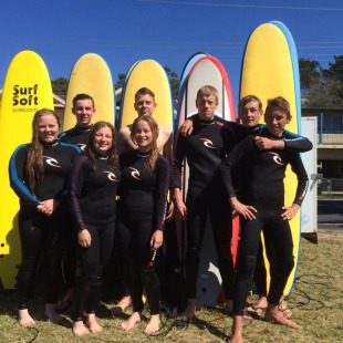 school group surfing lesson