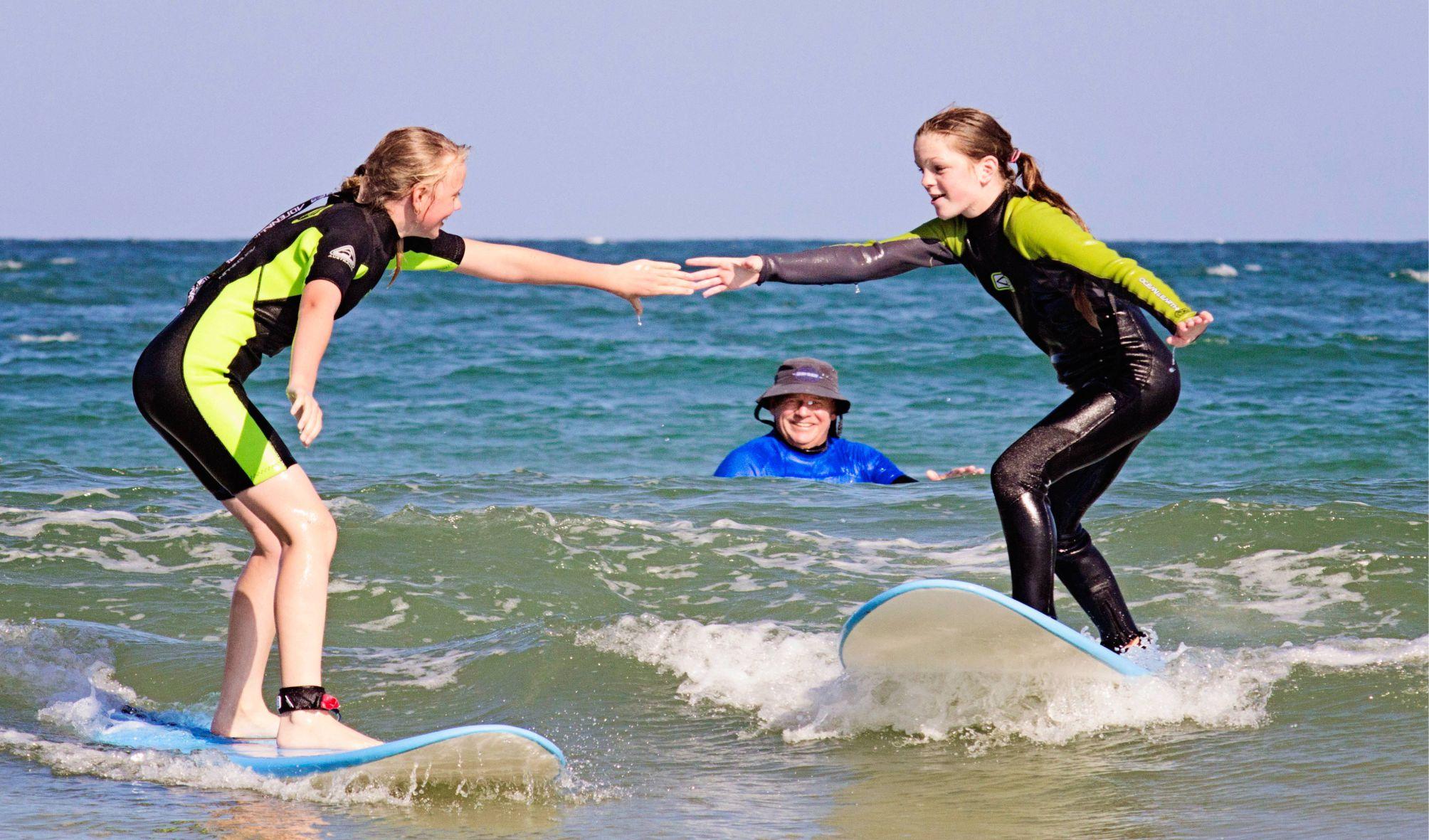 best friends surf together