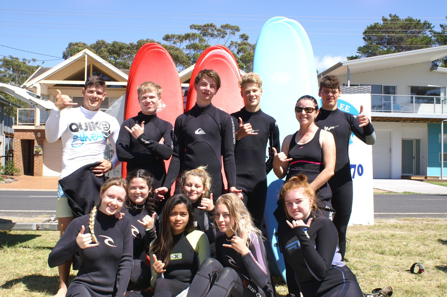 group surfing lessons are fun for the whole family